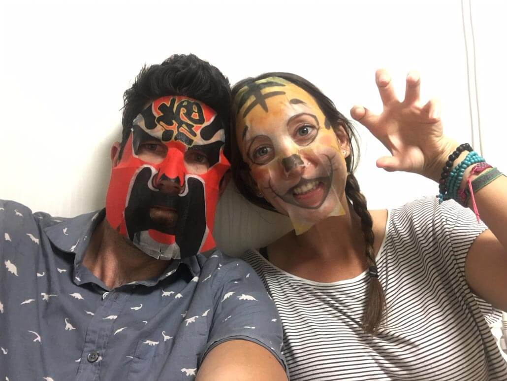 An american couple living in korea wearing masks