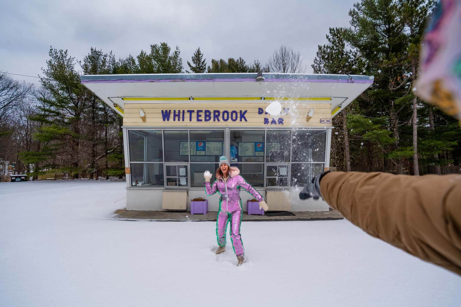 snowball fight at White Brook Dairy Bar in the Adirondacks at winter
