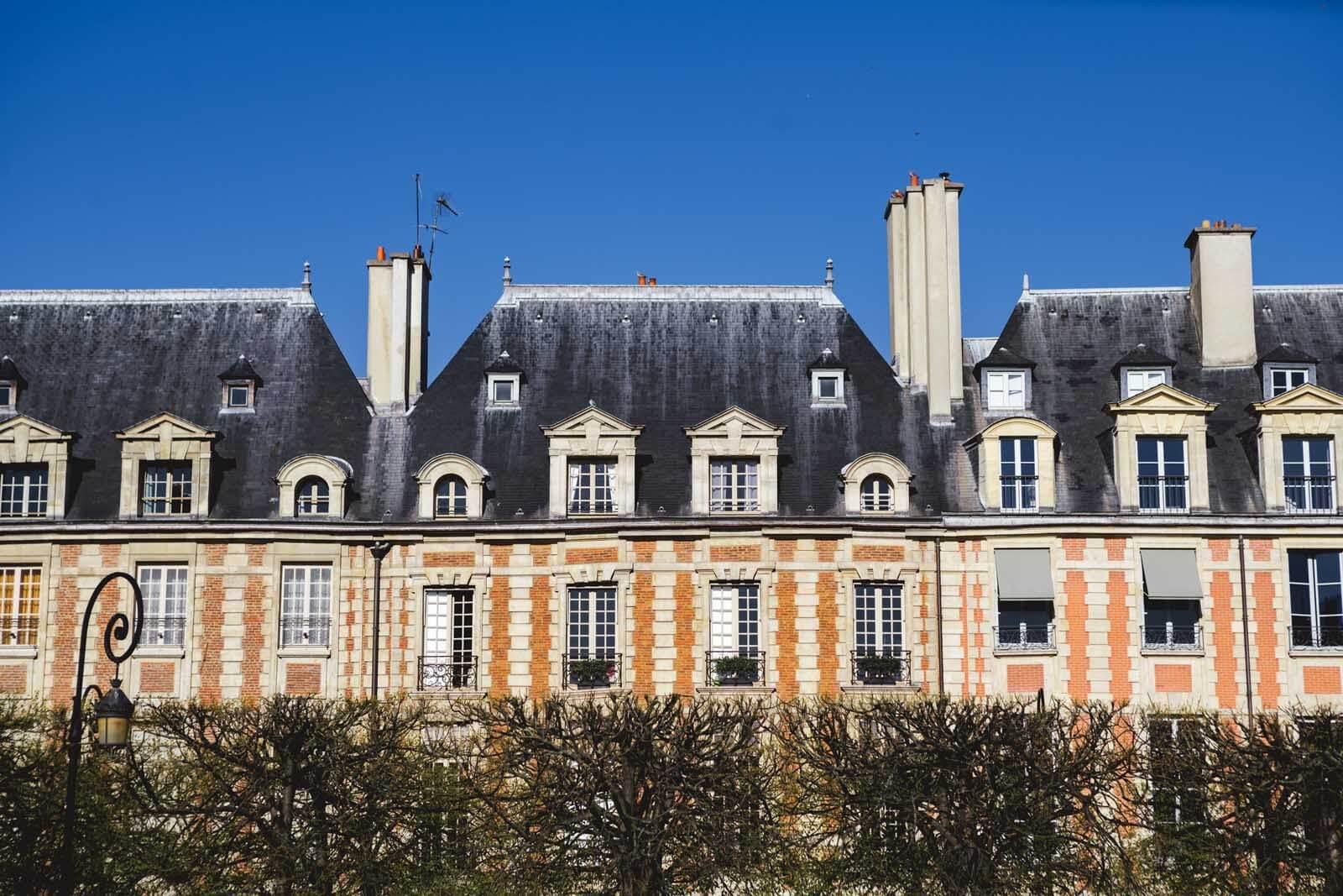 the beautiful patterns at place des vosges in le marais paris